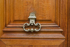 Brass door knocker on wooden door Stock Photography