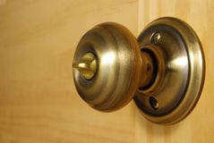 Brass doorknob close-up Royalty Free Stock Photography