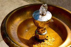 Brass drinking fountain. Up close image of drinking fountain with bubbling fresh water Stock Photo