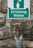 Brass drinking water outlet. Stock Photos