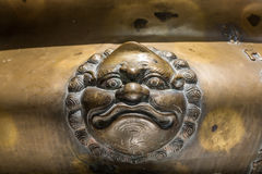 Brass face on incense pot. Stock Images