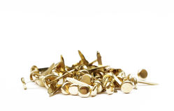 Brass Fastener. A pile of brads or brass fasteners royalty free stock photo