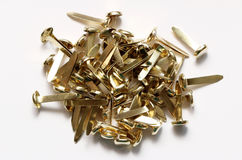 Brass Fastener. A pile of brads or brass fasteners royalty free stock photos