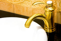 Brass faucet Stock Photography