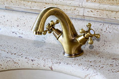 Brass faucet Stock Photos