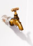 Brass faucet. As the drops of water. Stock Images