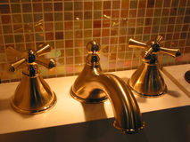 Brass faucet bathroom Stock Photography