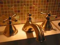 Brass faucet bathroom stock photography