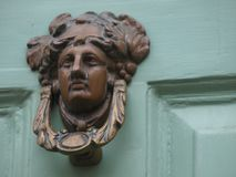 Brass figure head door knocker Royalty Free Stock Photos