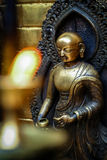 Brass figurine in a temple Royalty Free Stock Photography