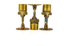 Brass fire sprinkler with copy space Royalty Free Stock Photo