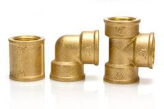 Brass fittings for plumbing pipes - gon, tee, sleeve Stock Photography