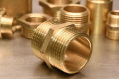 Brass Fittings for Water and Gas. On metal surface Stock Images