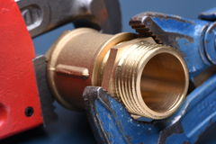 Brass fittings and wrench Stock Photography