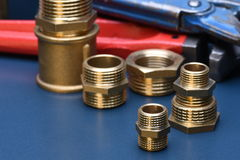 Brass fittings and wrench Royalty Free Stock Image