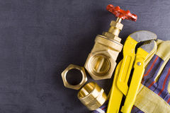 Brass fittings with wrench. Brass fittings, gate valve and wrench Stock Image