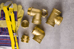 Brass fittings with wrench. Brass fittings, gate valve and wrench Royalty Free Stock Photos