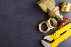 Brass fittings with wrench. Yellow brass fittings and gate valve background Royalty Free Stock Photo