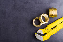 Brass fittings with wrench. Yellow brass fittings and gate valve background Stock Photos