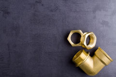 Brass fittings. Yellow brass fittings and gate valve background Royalty Free Stock Photography