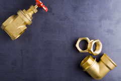 Brass fittings. Yellow brass fittings and gate valve background Stock Images