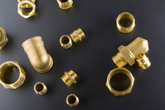 Brass fittings. Yellow brass fittings and gate valve background Stock Image