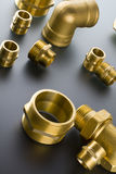 Brass fittings. Yellow brass fittings and gate valve background Stock Photo