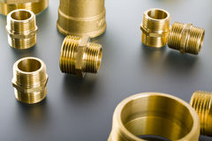 Brass fittings. Yellow brass fittings and gate valve background royalty free stock photo