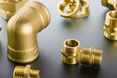 Brass fittings. Yellow brass fittings and gate valve background Stock Photos