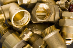 Brass fittings. Yellow brass fittings and gate valve background royalty free stock photos