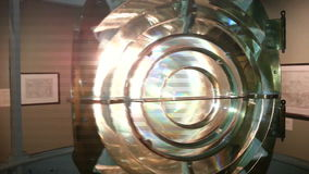 Brass Fresnel Lens Spinning with Light Shining stock video