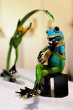 Brass frog guitarist Stock Images