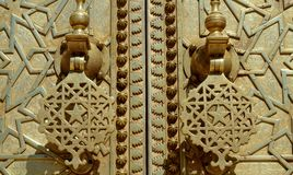 Brass gate with doorknockers Stock Images