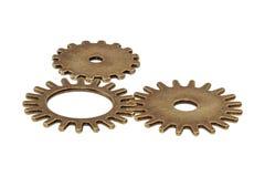 Brass gears on a white background. Brass gears isolated on a white background Stock Photos