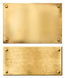 Brass or gold metal plates isolated. Brass or gold metal plates set isolated on white Royalty Free Stock Photography