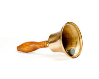 Brass handbell with wooden handle. Side view of handbell isolated against white royalty free stock photos