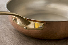 Brass Handle of Copper Skillet Stock Photo