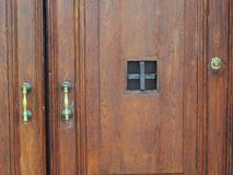 Brass Handles on Old Heavy Wooden Doors Royalty Free Stock Photography