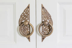 Brass handles with white doors Royalty Free Stock Photography