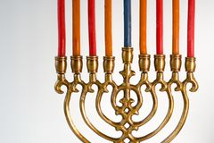 Brass hanukkah menorah with candles closeup. Horizontal Stock Photography