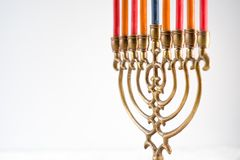 Brass hanukkah menorah with candles copy space. Horizontal Stock Images