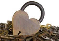 Brass heart lock surrounded by old keys isolated Royalty Free Stock Photo