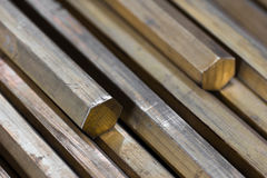 Brass hexagonal rods closeup Royalty Free Stock Photo