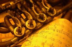 Brass instrument. Detail of an old brass instrument Stock Photo