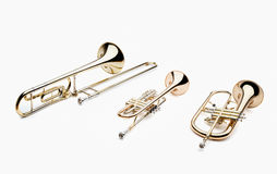 Brass instruments. Set of brass musical instruments on a white background, include trumpet, trombone, flugelhorn and french horn Trumpet, wind instruments Royalty Free Stock Image