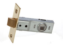 Brass interior door latch for securing door shut. Stock Photos
