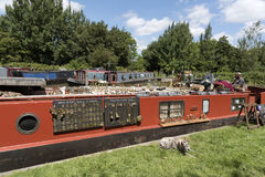 Brass items for sale on a narrowboat on an English canal Stock Photos