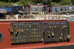 Brass items for sale on a narrowboat on an English canal Royalty Free Stock Photography