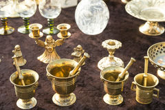 Brass jars and candle holders Royalty Free Stock Photography