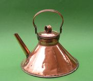 Antique or vintage copper kettle on green backgrou Royalty Free Stock Photos